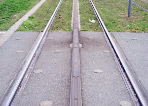 A section of APS track showing the neutral sections at the end of the powered segments plus one of the insulating joint boxes (from Wikipedia)